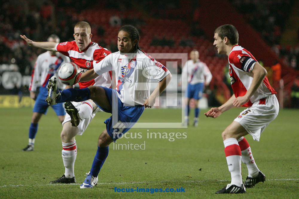 London - Tuesday December 27th, 2009: Mark Hudson (R) looks on as Nicky Bailey (L) of Charlton Athletic challenges Sean Scannell of Crystal Palace for the ball during the Coca Cola Championship match, London. (Pic by Mark Chapman/Focus Images)