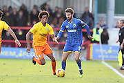 George Francomb of AFC Wimbledon gets there before Sido Jombati of Wycombe Wanderers during the Sky Bet League 2 match between AFC Wimbledon and Wycombe Wanderers at the Cherry Red Records Stadium, Kingston, England on 21 November 2015. Photo by Stuart Butcher.