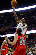 Apr 27, 2010; Cleveland, OH, USA; Cleveland Cavaliers forward Antawn Jamison (4) shoots over Chicago Bulls center Joakim Noah (13) as Chicago Bulls guard Derrick Rose (1) looks on during the first period in game five in the first round of the 2010 NBA playoffs at Quicken Loans Arena.  Mandatory Credit: Jason Miller-US PRESSWIRE