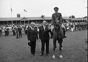 Guinness Competitions At The RDS Horse Show.(R39)..1986..09.08.1986..08.09.1986..9th August 1986..At the Dublin Horse Show at the RDS, Guinness sponsor several events,The Guinness Match International, The Novice Championship and the Guinness Tankard...Capt Gerry Mullins is pictured being presented with the Guinness Silver Tankard after finishing runner up to Eddie Macken in the leading rider category at the Horse Show. Lieut-Col Billy Ringrose is also pictured.