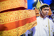 "01 FEBRUARY 2013 - PHNOM PENH, CAMBODIA:  An attendant in the funeral procession of former King Norodom Sihanouk early in the morning of Feb 1, before Sihanouk's funeral procession left the palace. Norodom Sihanouk (31 October 1922 - 15 October 2012) was the King of Cambodia from 1941 to 1955 and again from 1993 to 2004. He was the effective ruler of Cambodia from 1953 to 1970. After his second abdication in 2004, he was given the honorific of ""The King-Father of Cambodia."" Sihanouk died in Beijing, China, where he was receiving medical care, on Oct. 15, 2012. His cremation is will be on Feb. 4, 2013. Over a million people are expected to attend the service.   PHOTO BY JACK KURTZ"