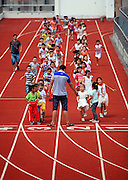 TIANTAI, CHINA - SEPTEMBER 01: (CHINA OUT) <br /> <br /> Athletics Track On The Building<br /> <br /> Children run along the 200m track on a teaching building at No.2 Primary School on September 1, 2014 in Tiantai County, Zhejiang Province of China. Due to the school doesn't have enough land for construction, it built the athletics track on the top of a four-storey teaching building. <br /> ©Exclusivepix