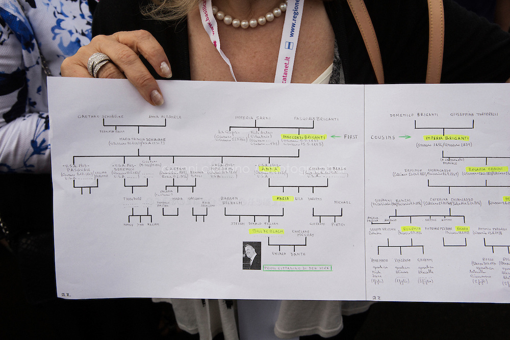 GRASSANO, ITALY - 24 JULY 2014:  A relative of Mayor of New York Bill de Blasio shows the de Blasio/Briganti  family tree in Grassano, Mr de Blasio's ancestral home town in Italy, on July 24th 2014.<br /> <br /> New York City Mayor Bill de Blasio arrived in Italy with his family Sunday morning for an 8-day summer vacation that includes meetings with government officials and sightseeing in his ancestral homeland.