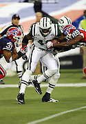 New York Jets fullback Tony Richardson (49) gets gang tackled by Buffalo Bills cornerbacks Jairus Byrd (31) and Drayton Florence (29) during the NFL football game against the Buffalo Bills, December 3, 2009 in Toronto, Canada. The Jets won the game 19-13. ©Paul Anthony Spinelli