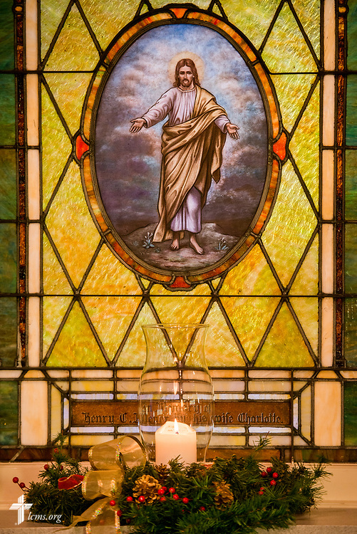Stained glass depicting Jesus Christ with a candle for Christmas at Holy Cross Lutheran Church, Collinsville, Ill., on Monday, Nov. 27, 2017. LCMS Communications/Erik M. Lunsford