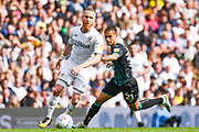 Leeds United midfielder Adam Forshaw (4) and Swansea City midfielder Yan Dhanda (21) during the EFL Sky Bet Championship match between Leeds United and Swansea City at Elland Road, Leeds, England on 31 August 2019.
