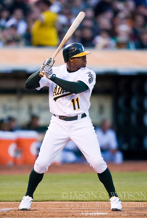 April 5, 2010; Oakland, CA, USA;  Oakland Athletics center fielder Rajai Davis (11) at bat during the first inning against the Seattle Mariners at Oakland-Alameda County Coliseum. Seattle defeated Oakland 5-3.