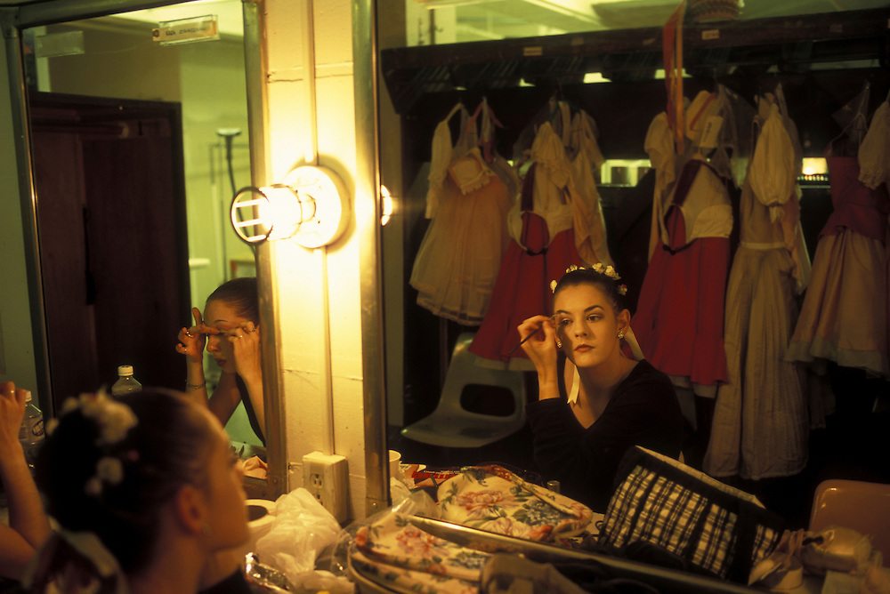 USA, Washington, Seattle, Brittany Reid applies make-up before dancing in Pacific Northwest Ballet performance of Coppélia