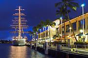 A tall ship docked at the Aloha Tower in Honolulu, Hawaii.