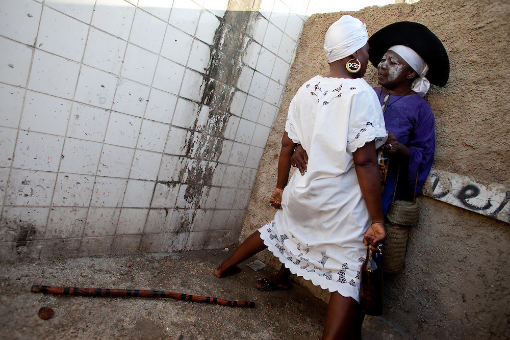 Two Gede, or devotees possessed by Gede spirits. November 1st and 2nd, known in Haiti as Gede, are a celebration of All Saints Day and All Souls Day. In Vodou, the Gede are the spirits that embody the powers of death and fertility. Practitioners come to the National Cemetery to honor their ancestors and to petition the spirits.
