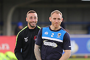 Barry Fuller (Captain) defender for AFC Wimbledon (2) and Sammy Moore midfielder for Leyton Orient (14) was at AFC Wimbledon for 5 seasons prior the Sky Bet League 2 match between AFC Wimbledon and Leyton Orient at the Cherry Red Records Stadium, Kingston, England on 23 April 2016. Photo by Stuart Butcher.