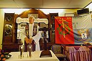 Nederland, Schin op Geul, 20031206.<br /> Pastoor van Schin op Geul in Limburg draagt de mis op. Tijdens de offerande houdt hij de kelken met brood en wijn omhoog. Op de achtergrond een bord met de spreuk: &quot;Heilige Barbara Bid voor ons&quot;. Rechts het vaandel van de mijnwerkers van Berg en Terblijt.<br /> <br /> Huldiging jubilarissen 2003 van de FNV in HOTEL SALDEN,  te Schin op Geul. <br /> Om 10.00 uur in de ochtend is de aanvang van de Heilige Mis voor de levende en overleden leden van de woonafdeling Groot Valkenburg. De mis is ter ere van St. Barbara, de beschermheilige van de mijnwerkers.<br /> Na de H.Mis Limburgse koffietafel.<br /> <br /> geloof / kerk /
