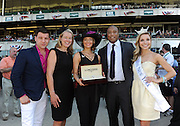 New York Yankees legend Bernie Williams, second right, Miss New York Kira Kazantsev, right, Longines' Jennifer Judkins, second left, and Tom Murro, of Fox Morning Extra, left, present a Longines timepiece to Kelly Davis, center, of New York, who won the Longines Most Elegant Woman at Belmont fashion contest, Saturday, June 7, 2014, at Belmont Park in New York.  Longines, the Swiss watchmaker known for its elegant timepieces, is the Official Watch and Timekeeper of the 146th running of the Belmont Stakes. (Photo by Diane Bondareff/Invision for Longines/AP Images)