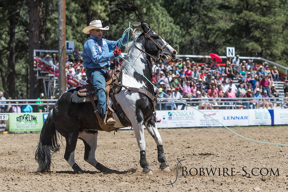 Heeler Ryon Tittel makes his team roping run in the first performance of the Elizabeth Stampede on Saturday, June 2, 2018.