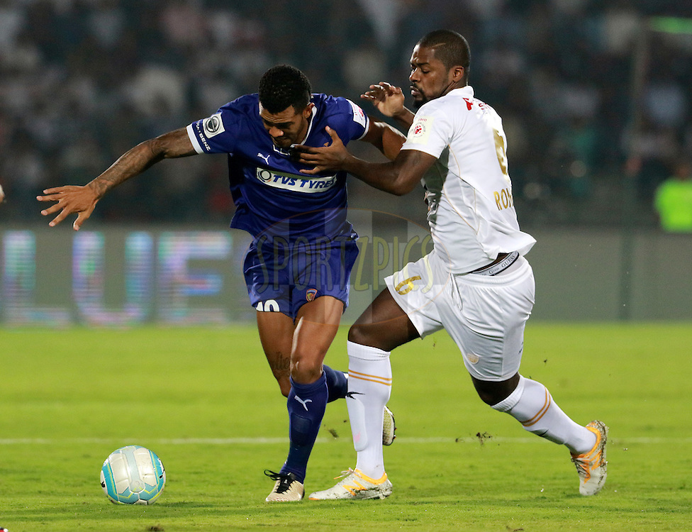 Raphael Augusto of Chennaiyin FC and Romaric of NorthEast United FC in action during match 18 of the Indian Super League (ISL) season 3 between NorthEast United FC and Chennaiyin FC held at the Indira Gandhi Athletic Stadium in Guwahati, India on the 20th October 2016.<br /> <br /> Photo by Vipin Pawar / ISL/ SPORTZPICS