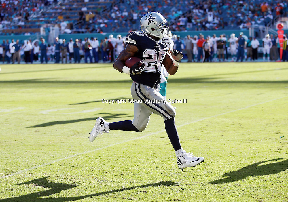 Dallas Cowboys running back Darren McFadden (20) sprints up field on a 35 yard run to the Miami Dolphins 9 yard line in the third quarter during the 2015 week 11 regular season NFL football game against the Miami Dolphins on Sunday, Nov. 22, 2015 in Miami. The Cowboys won the game 24-14. (©Paul Anthony Spinelli)