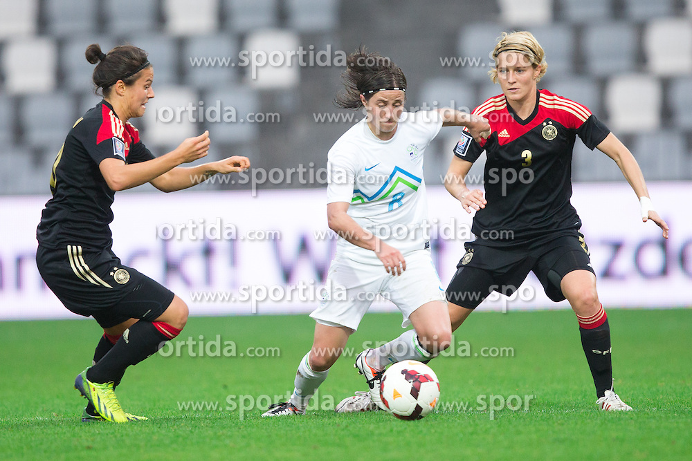 Mateja Zver of Slovenia vs Dzsenifer Marozsan of Germany and Saskia Bartusiak of Germany during FIFA Women's World Cup 2015 Group A qualification match between Slovenia and Germany on October 26, 2013 in SRC Bonifika, Koper, Slovenia. (Photo by Matic Klansek Velej / Sportida.com)