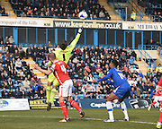Crewe goalkeeper Ben Garratt palms away a cross during the Sky Bet League 1 match between Gillingham and Crewe Alexandra at the MEMS Priestfield Stadium, Gillingham, England on 12 March 2016. Photo by David Charbit.