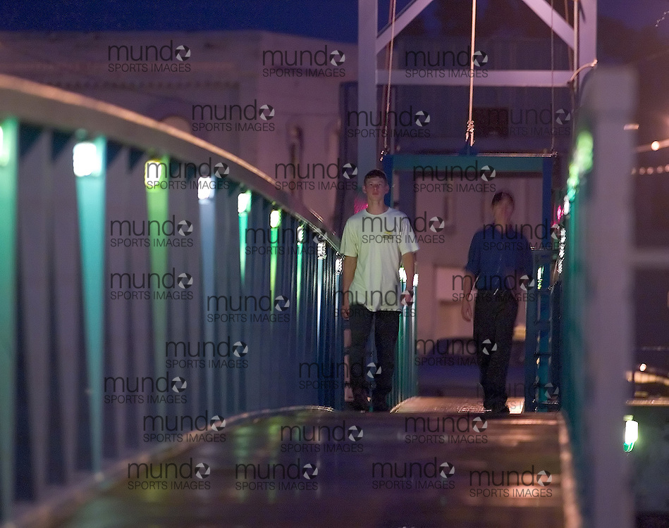 Wallaceburg, Ontario ---06/7/26---  Peter Woelpe, left, and Jake Dyck walk over the foot bridge in downtown Wallaceburg at 9:38pm..GEOFF ROBINS/ Chatham Daily News<br />