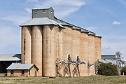 Grain silo rail transport depot in Mirrool in rural country New South Wales, Australia. <br />