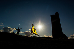 © Licensed to London News Pictures. 28/08/2015. Huddersfield, UK. Picture shows 13 year old Jordan flying his kite next to Victoria Tower on Castle Hill in Huddersfield. Whilst the UK is expecting unsettled weather over the bank holiday weekend Yorkshire is experiencing clear skies & bright sunshine. Photo credit: Andrew McCaren/LNP
