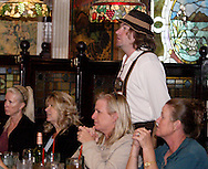 """Jerry Francis (standing) during Mayhem & Mystery's production of """"Festival Fracas"""" at the Spaghetti Warehouse in downtown Dayton, Monday, September 27, 2010."""