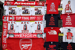 Arsenal merchandise on sale outside the ground before the Premier League match at the Emirates Stadium, London.