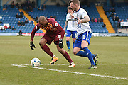 Bradford City Forward, Wes Thomas and Bury Defender, Peter Clarke on the edge of the box during the Sky Bet League 1 match between Bury and Bradford City at the JD Stadium, Bury, England on 5 March 2016. Photo by Mark Pollitt.