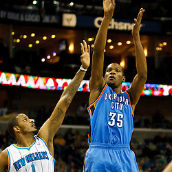 January 24,  2011; New Orleans, LA, USA; Oklahoma City Thunder small forward Kevin Durant (35) shoots over New Orleans Hornets small forward Trevor Ariza (1) during the third quarter at the New Orleans Arena. The Hornets defeated the Thunder 91-89. Mandatory Credit: Derick E. Hingle