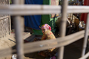 A woman in front of her bamboo shelter at the Badupa Camp near Sittwe. 2015-02-05.<br />
