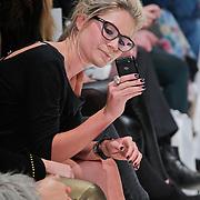 NLD/Amsterdam/20110127 - AIFW winter 2011, show Spijkers en Spijkers, Nikki Plessen maakt een foto voor twitter