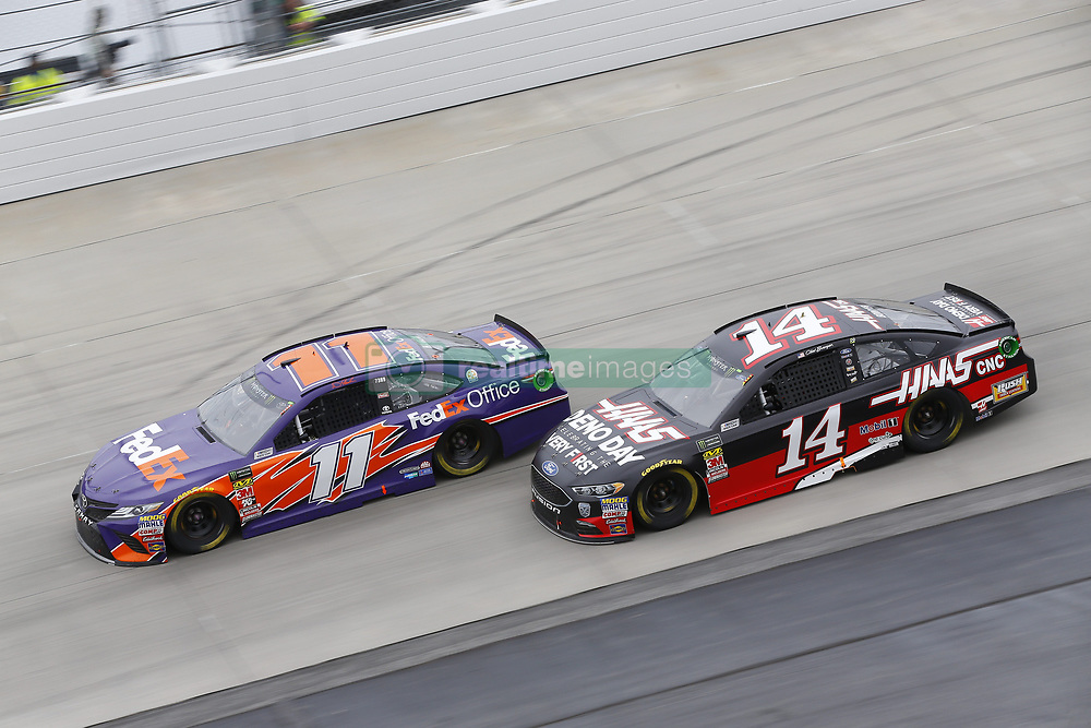 May 6, 2018 - Dover, Delaware, United States of America - Denny Hamlin (11) and Clint Bowyer (14) battle for position during the AAA 400 Drive for Autism at Dover International Speedway in Dover, Delaware. (Credit Image: © Chris Owens Asp Inc/ASP via ZUMA Wire)