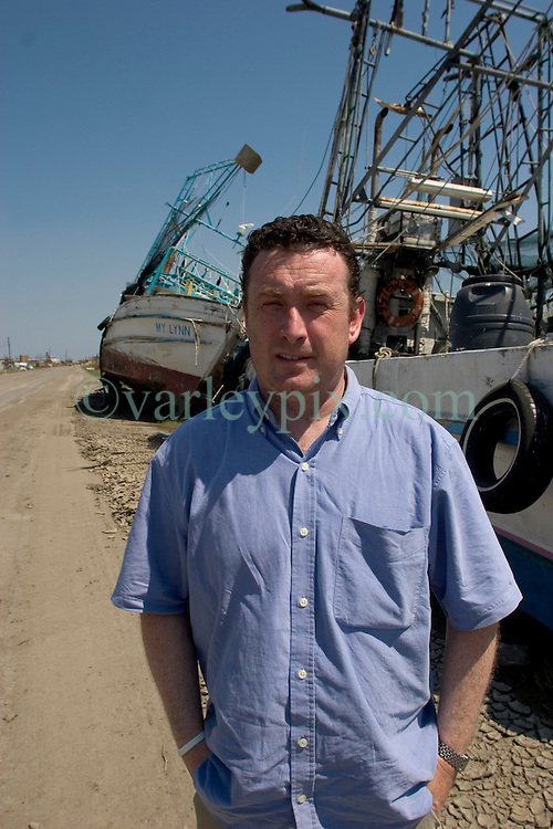 08 Sept 2005. New Orleans, Louisiana. Hurricane Katrina aftermath. <br /> The Daily Mirror's Aidan McGurran in East New Orleans, where the tidal surge washed over the land and devastated homes and property dumping ships on the Chef Menteur highway.<br /> Photo; &copy;Charlie Varley/varleypix.com