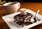 Camp-fire s'mores - Homemade graham cracker, gooey marshmallow & Hershey bars warmed in our wood-fired oven..