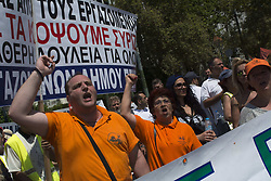 June 22, 2017 - Athens, Greece - Protesters march holding banners and shouting slogans against the government. Municipal fixed term workers took to the streets to demand their contracts are changed to permanent. (Credit Image: © Nikolas Georgiou via ZUMA Wire)