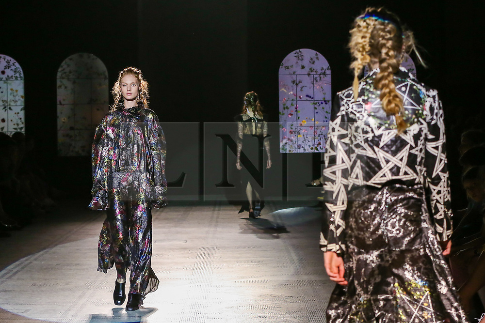 "© Licensed to London News Pictures. 21/06/2019. London, UK. A model presents Preen by Thornton Bregazzi at the ""Fashion in Motion"" at V&A Museum, wearing colourful pieces from the designers' current collection and their archive themed around floral motifs and pagan references which coincides with the Summer Solstice and its celebration of light, nature and growth. Photo credit: Dinendra Haria/LNP"