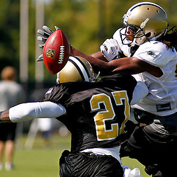 July 31, 2011; Metairie, LA, USA; New Orleans Saints cornerback Malcolm Jenkins (27) knocks the ball away from wide receiver Montez Billings (89) during training camp practice at the New Orleans Saints practice facility. Mandatory Credit: Derick E. Hingle