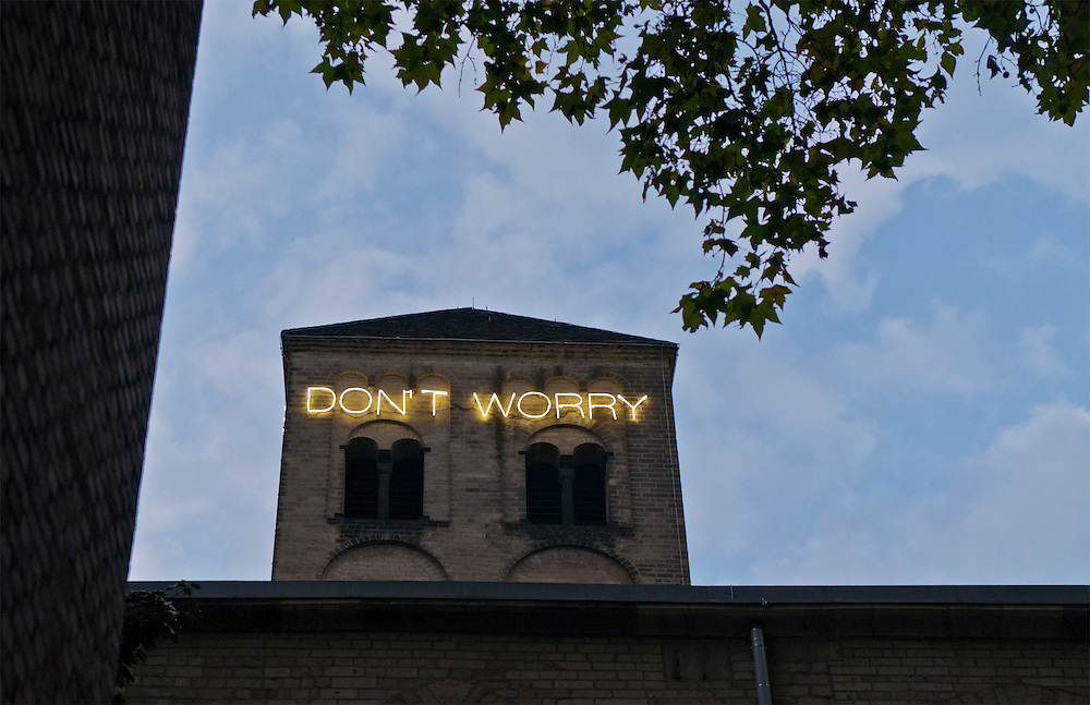 "05.09.2012,Deutschland,Köln, Romanischer Turm von Sankt Peter Köln mit dauerhafter Lichtinstallation DON'T WORRY von Martin Creed  |Germany, Cologne,Köln, Art work ""Don´t worry"" by Martin Creed on top of the tower of the Church St.Peter known as Kunst-Station Sankt Peter"