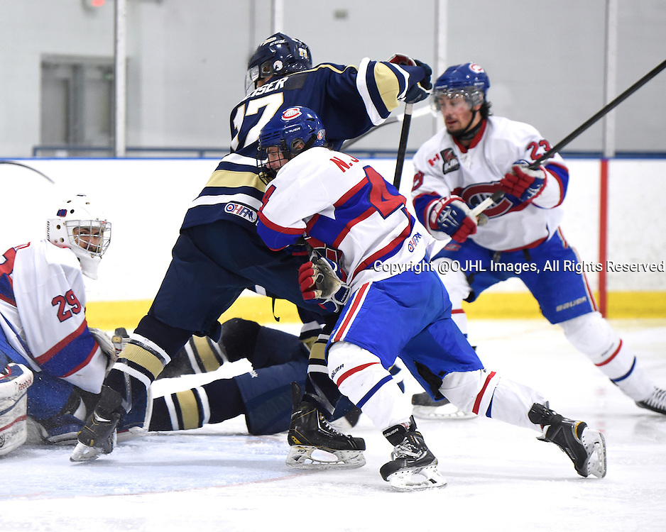 TORONTO, ON - Mar 29, 2015 : Ontario Junior Hockey League game action between the Toronto Patriots and the Toronto Jr. Canadiens. Game two of the South West Championship Series. Nicholas Jarzabek #44 of the Toronto Jr. Canadiens protects the crease from Nicholas Geiser #17 of the Toronto Patriots during the third period. <br /> (Photo by Andy Corneau / OJHL Images)