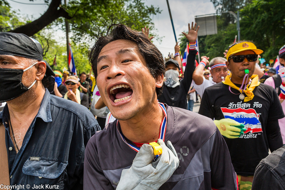 26 NOVEMBER 2013 - BANGKOK, THAILAND: A Thai anti-government protestor screams at riot police in Bangkok. Protestors opposed to the government of Thai Prime Minister Yingluck Shinawatra spread out through Bangkok this week. Protestors have taken over the Ministry of Finance, Ministry of Sports and Tourism, Ministry of the Interior and other smaller ministries. The protestors are demanding the Prime Minister resign, the Prime Minister said she will not step down. This is the worst political turmoil in Thailand since 2010 when 90 civilians were killed in an army crackdown against Red Shirt protestors. The Pheu Thai party, supported by the Red Shirts, won the 2011 election and now govern. The protestors demanding the Prime Minister step down are related to the Yellow Shirt protestors that closed airports in Thailand in 2008.     PHOTO BY JACK KURTZ