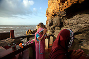 Morning Prayers at the Gangeshwar Temple, which is cut into the rock face by the sea at Fudam in Diu. The temple is dedicated to Lord Shiva and has 5 lingas. Legend has it that these 5 lingas were created by the 5 Padavas during their exile.