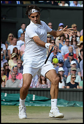 Image licensed to i-Images Picture Agency. 06/07/2014. London, United Kingdom. Rodger Federer is beaton by Novak Djokovic in the Wimbledon Men's Final.  Picture by Andrew Parsons / i-Images