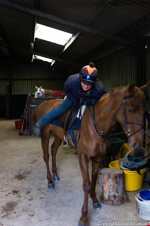 Jockey Joanna Walton mounts Ginny for exercise a few days before the Knight Frank Hunt Ride.