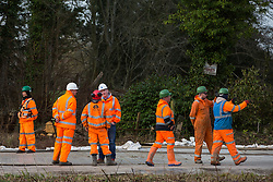 Denham, UK. 5 February, 2020. Engineers and security guards survey land cleared at Buckinghamshire Golf Club in the Colne Valley for works planned in conjunction with the HS2 high-speed rail link including the felling of mature trees in a nature reserve on the other side of the river Colne and the construction of a Bailey bridge across the river. Environmental activists are occupying trees in Denham Country Park in an attempt to prevent or hinder the work.