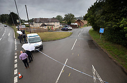 © Licensed to London News Pictures. 16/08/2019. Sulhamstead, UK. The scene at the junction of the A4 (L) and Lambdens Lane near Sulhamstead, Berkshire, where a police officer was killed while investigating a suspected burglary. Ten people have been arrested on suspicion of murder including a 13-year-old child. Photo credit: Peter Macdiarmid/LNP