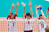 Poland, Warsaw - 2017 August 24: (L-R) Dawid Konarski and Bartlomiej Lemanski and Michal Kubiak all from Poland blok the ball during LOTTO EUROVOLLEY POLAND 2017 - European Championships in volleyball at Stadion PGE Narodowy on August 24, 2017 in Warsaw, Poland.<br /> <br /> Mandatory credit:<br /> Photo by © Adam Nurkiewicz<br /> <br /> Adam Nurkiewicz declares that he has no rights to the image of people at the photographs of his authorship.<br /> <br /> Picture also available in RAW (NEF) or TIFF format on special request.<br /> <br /> Any editorial, commercial or promotional use requires written permission from the author of image.