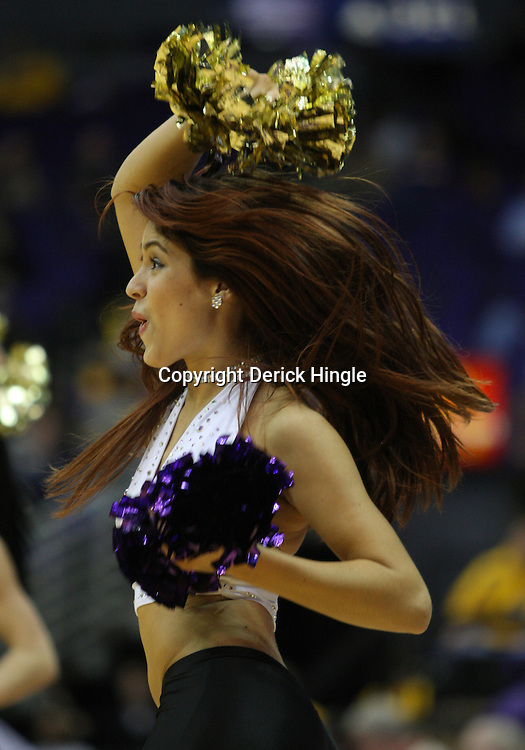Jan 04, 2010; Baton Rouge, LA, USA; A LSU Tiger Girls dancer performs during the second half of a game against the McNeese State Cowboys at the Pete Maravich Assembly Center. LSU defeated McNeese State 83-60.  Mandatory Credit: Derick E. Hingle-US PRESSWIRE