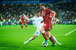 Marco Asensio of Real Madrid vs Adam Lallana of Liverpool during the UEFA Champions League final football match between Liverpool and Real Madrid at the Olympic Stadium in Kiev, Ukraine on May 26, 2018.Photo by Sandi Fiser / Sportida