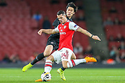 Eintracht Frankfurt midfielder Daichi Kamada (15) and Arsenal midfielder Granit Xhaka (34) during the Europa League match between Arsenal and Eintracht Frankfurt at the Emirates Stadium, London, England on 28 November 2019.