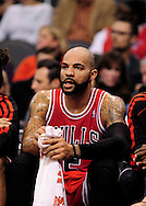 Nov. 14, 2012; Phoenix, AZ, USA; Chicago Bulls forward Carlos Boozer (5) sits on the bench during the game against the Phoenix Suns at the US Airways Center. The Bulls defeated the Suns 112-106 in overtime. Mandatory Credit: Jennifer Stewart-USA TODAY Sports